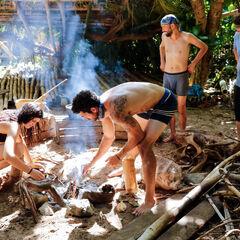 Manu making fire.