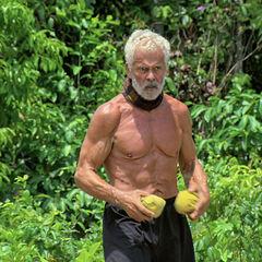 Joe prepares to toss his final two sandbags.