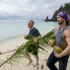 Mike carrying coconuts with John.