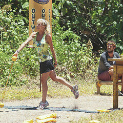 Tina throws a ball in the Immunity Challenge, <i>Chain Reaction</i>.