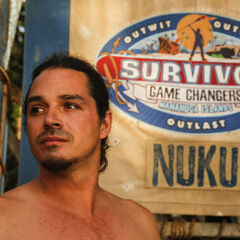 Ozzy in front of the Nuku flag.