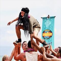 Jarrad is hoisted up by his tribemates at the first Immunity Challenge.