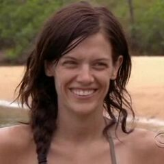 Erinn smiles when she learns that she wasn't going to be voted out.