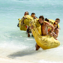 Kama carrying their snake during the challenge.