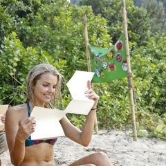 Andrea reading her letters from home.