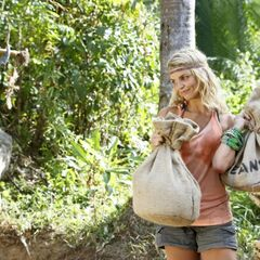 Andrea giving up her food item to supply the tribe with rice and beans.