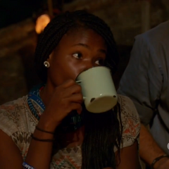 Michaela drinking water at Tribal Council.