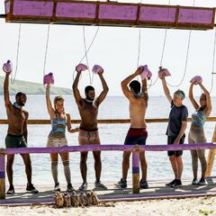 The purple team competes in <i>David vs. Goliath</i>.