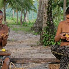 Tai and Michele enjoying mango.