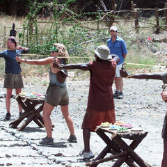 Vecepia along with other tribe mates competing in the final six Immunity Challenge, <i><a href=