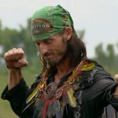 Coach poses after winning immunity.