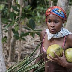 Michaela carrying coconuts.