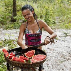 Monica cutting watermelons.