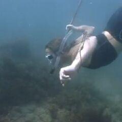 Susan fishing for Tagi.