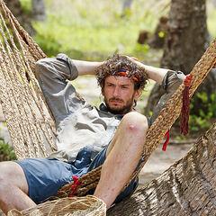 Neal lies in a hammock.