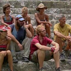 The final seven listening to instructions for the Immunity Challenge.