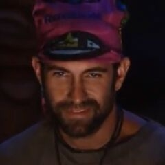 John smirking after Rob's elimination.