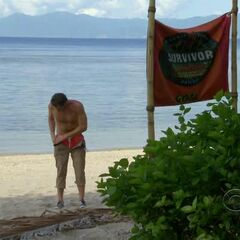 Reynold hiding the idol in his pants.