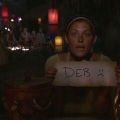 Michele votes against Debbie.