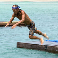 Tai leaps into the water during the final six <a href=