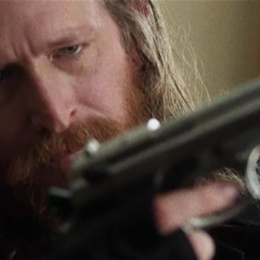 Max with a gun, in the first flashback.