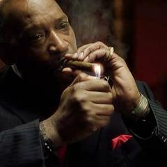 Lights a cigar.