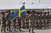 Swedish ISAF soldiers with banner