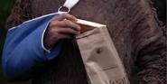 Keras holding Chocolate bar