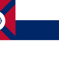 A variant of the 2nd National Flag with recoloured Bars and a Battle Cross and Hexagon canton