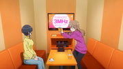 Miyu taking pictures of Karen's new hairstyle in excitement AGGO S01E06