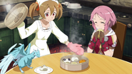 Silica serving pork buns to Lisbeth