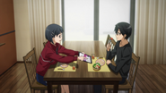 Suguha showing BoB news article to Kazuto