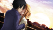 Asuna and Kazuto kissing at sunset in real world