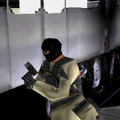 Terrorist with 9mm in front of train.