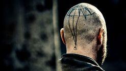 Taboo-Still-S1E02-Character-Atticus-Tattoo