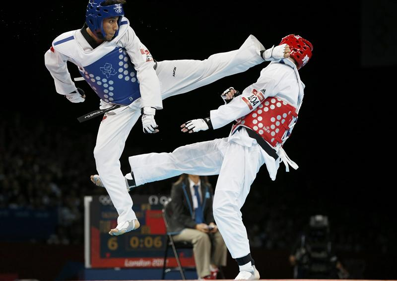 https://vignette.wikia.nocookie.net/taekwondo/images/1/18/WTF_sparring.jpg/revision/latest?cb=20140608221158