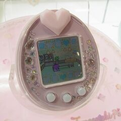 A pink Tamagotchi P's on display