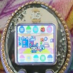 Moriritchi on the Tamagotchi iD L (with a baby)