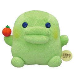 A Kuchipatchi plush with an apple