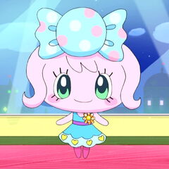 Candy Pakupaku wearing a blue dress designed by Miraitchi and Clulutchi