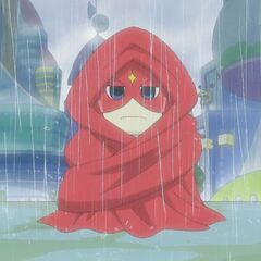 Gotchiman wrapped up in a large cape