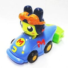 A Happy Meal toy of Mametchi in a racecar