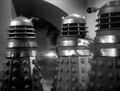 3 Daleks cutting through door.jpg