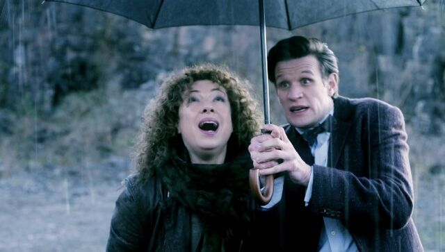 File:Rain Gods The Doctor & River.jpg