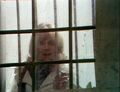 Jo close up prison window - Sea Devils.jpg