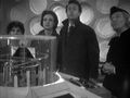 Crew looking up at TARDIS scanner CaveofSkulls.jpg
