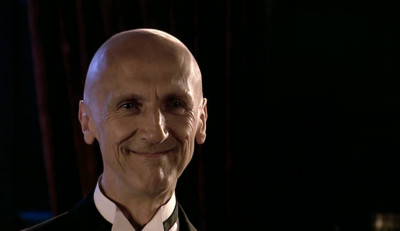 File:Father Angelo smirking.jpg
