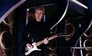 Doctor playing electric guitar in the TARDIS