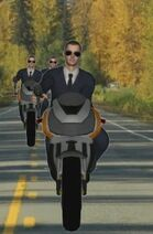 Men in suits on motorcycles