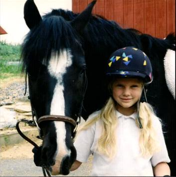 File:Young Taylor with her horse.jpg
